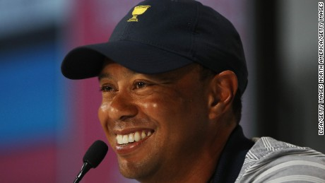 JERSEY CITY, NJ - SEPTEMBER 27:  Captain's assistant Tiger Woods of the U.S. Team attends a press conference during practice rounds prior to the Presidents Cup at Liberty National Golf Club on September 27, 2017 in Jersey City, New Jersey.  (Photo by Elsa/Getty Images)