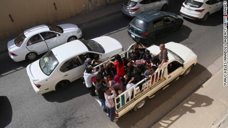 Families flee Kirkuk on the road to Erbil and Sulaymaniyah on Monday.