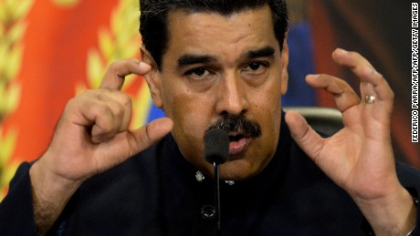 "Venezuelan President Nicolas Maduro gestures during a press conference with international media correspondents at the Miraflores Presidential Palace in Caracas on October 17, 2017. Maduro said his socialist party's landslide victory in disputed regional elections had delivered a ""strong message"" to the United States and its allies. / AFP PHOTO / FEDERICO PARRA        (Photo credit should read FEDERICO PARRA/AFP/Getty Images)"