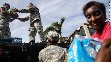US soldiers unload food and water from FEMA on Tuesday in San Isidro, Puerto Rico.
