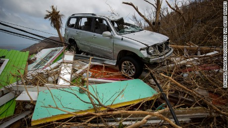 A damaged sports utility vehicle (SUV) sits on top of debris from the destroyed Chateau Bordeaux restaurant after Hurricane Irma at Coral Bay in St John, U.S. Virgin Islands, on Tuesday, Sept. 12, 2017. After being struck by Irma last week, the U.S. Virgin Islands couldn't look less like a tourist destination. Many local residents are giving up and getting out after losing everything to the category 5 storm, even as the local authorities in the U.S. territory say they are determined to rebuild the islands. Photographer: Michael Nagle/Bloomberg via Getty Images