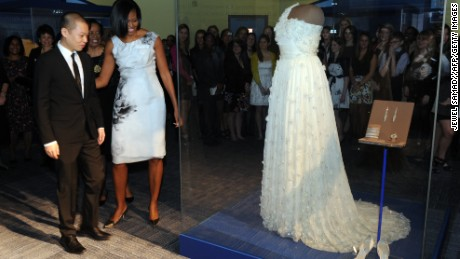 Obama and designer Jason Wu look at a display of her inaugural gown at the Smithsonian's National Museum of American History.