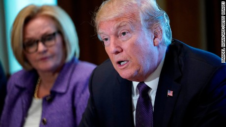 US President Donald Trump (R) speaks next to Senator Claire McCaskill (D) of Missouri during a meeting with members of the the Senate Finance Committee in the Cabinet Room at the White House in Washington, DC, on October 18, 2017. / AFP PHOTO / Mandel NGAN        (Photo credit should read MANDEL NGAN/AFP/Getty Images)