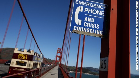 SAN FRANCISCO, CA - MARCH 12:  A sign is posted alerting people to use an emergency crisis counseling phone if in distress on the Golden Gate Bridge on March 12, 2014 in San Francisco, California.  A long debated suicide barrier on the Golden Gate Bridge could be one step closer to  reality after Caltrans and the regional Metropolitan Transportation Commission have indicated that they will be willing to contribute $44 million toward putting giant nets under the span of the bridge. The Golden Gate Bridge district would need to invest $12 million in toll money to cover the remaining cost. Over 1,500 people committed suicide by jumping from the iconic bridge since it opened in 1937. 46 people jumped to their death in 2013.  (Photo by Justin Sullivan/Getty Images)