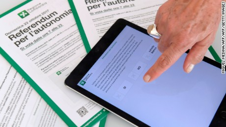 A person shows an App that will allow to vote for a referendum in Italy's northern region of Lombardy to request more autonomy from central government, on October 13, 2017 in Milan.  A referendum will be held on October 22, 2017 in the Italian regions of Lombardy and Veneto, both ruled by rightwing party Northern League, to ask for more fiscal autonomy and more powers to decide how to allocate financial resources. / AFP PHOTO / MIGUEL MEDINA        (Photo credit should read MIGUEL MEDINA/AFP/Getty Images)