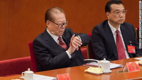 Former president Jiang Zemin was spotted looking at his watch during Xi's speech, which lasted more than three hours.