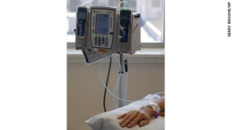 FILE - In this Sept. 5, 2013 file photo, an infusion drug to treat cancer is administered to a cancer patient via intravenous drip at Duke Cancer Center in Durham, N.C. According to a study that was discussed Saturday, May 31, 2014, at a cancer conference in Chicago, Eli Lilly and Co.'s experimental drug Cyramza has extended the life of patients with advanced lung cancer who relapsed after standard chemotherapy. (AP Photo/Gerry Broome, File)