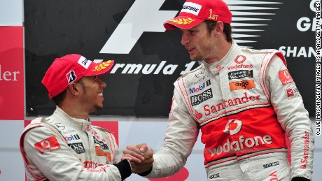 SHANGHAI, CHINA - APRIL 18:  Race winner Jenson Button (R) of Great Britain and McLaren Mercedes is congratulated on the podium by second placed team mate Lewis Hamilton (L) of Great Britain and McLaren Mercedes following the Chinese Formula One Grand Prix at the Shanghai International Circuit on April 18, 2010 in Shanghai, China.  (Photo by Clive Mason/Getty Images)