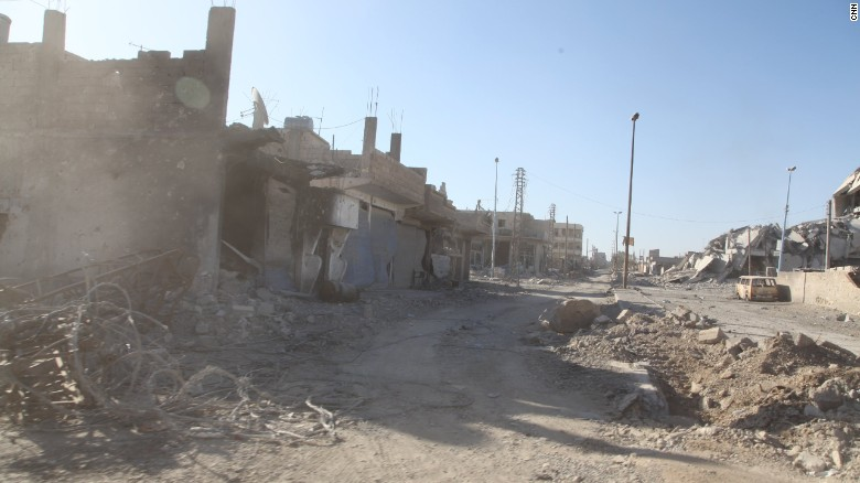 Walking through the ruins of Raqqa