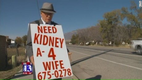 A 74-year-old Utah man says he is walking busy streets near his home wearing a sandwich board to help find a donor for his wife who is suffering from kidney failure.
