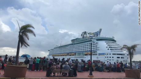 Puerto Ricans line up to try and board a cruise ship to leave the island.