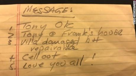 One of the many notes handed to CNN asking to relay information to families.