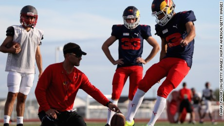 Ricciardo and Red Bull teammate Max Verstappen take part in a training session with the Del Valle Cardinals High School team