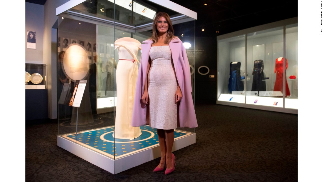 "First lady Melania Trump stands alongside the gown she wore to the 2017 inaugural balls as <a href=""http://www.cnn.com/2017/10/18/politics/melania-trump-gown-smithsonian/index.html"">she donates the dress</a> to the Smithsonian's First Ladies Collection at the Smithsonian National Museum of American History in Washington on October 20, 2017."