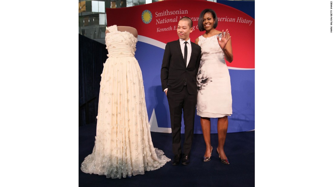 First lady Michelle Obama and inaugural dress designer Jason Wu look at her inaugural gown that's now on display at the Smithsonian museum on March 9, 2010.