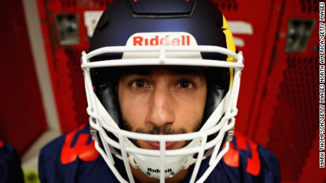 AUSTIN, TX - OCTOBER 19: Daniel Ricciardo of Australia and Red Bull Racing prepares for a training session with the Del Valle Cardinals High School Football Team during previews ahead of the United States Formula One Grand Prix at Circuit of The Americas on October 19, 2017 in Austin, Texas.  (Photo by Mark Thompson/Getty Images)
