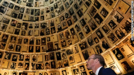Irish Foreign Minister Simon Coveney looks at pictures of Jewish Holocaust victims on July 11, 2017, at the Hall of Names during his visit to the Yad Vashem Holocaust Memorial museum in Jerusalem, commemorating the six million Jews killed by the Nazis during World War II. / AFP PHOTO / GALI TIBBONGALI TIBBON/AFP/Getty Images