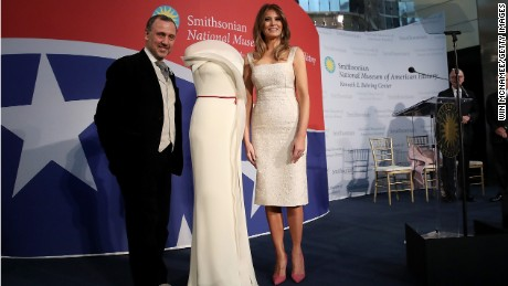 U.S. first lady Melania Trump and fashion designer Herve Pierre attend an event at the Smithsonian National Museum of American History where the first lady donated her inaugural gown to the museum October 20, 2017 in Washington, DC. The first lady said, 'Today is such an honor as I dedicate my inaugural couture piece to the First Ladies exhibit at the National Museum of American History.'