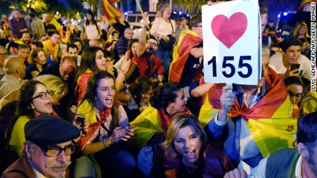 Protesters with Spanish flags shout slogans in favour of Spanish Constitution and the implementation of its 155 article, during a demonstration defending a united Spain on October 4, 2017 in Barcelona. Catalonia could declare independence on October 9, a regional government source told AFP, as a crisis escalates between Madrid and separatist leaders over an illegal independence referendum. / AFP PHOTO / LLUIS GENE        (Photo credit should read LLUIS GENE/AFP/Getty Images)