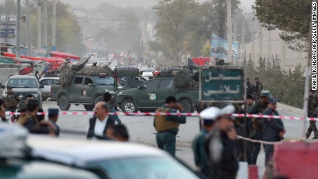 Security personnel gather Saturday near the site of the suicide bomb attack in the Afghan capital.