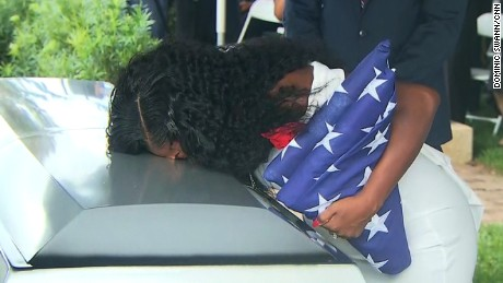 Sgt. La David Johnson's widow kisses his casket before it's buried in the Hollywood Memorial Gardens on October 21, 2017.