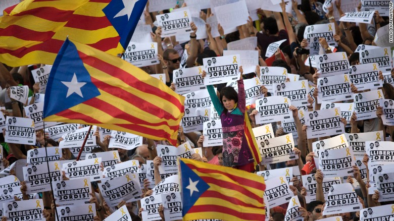 "Protesters hold signs reading ""Freedom for the two Jordis"" on Saturday, referring to two jailed Catalan activists."