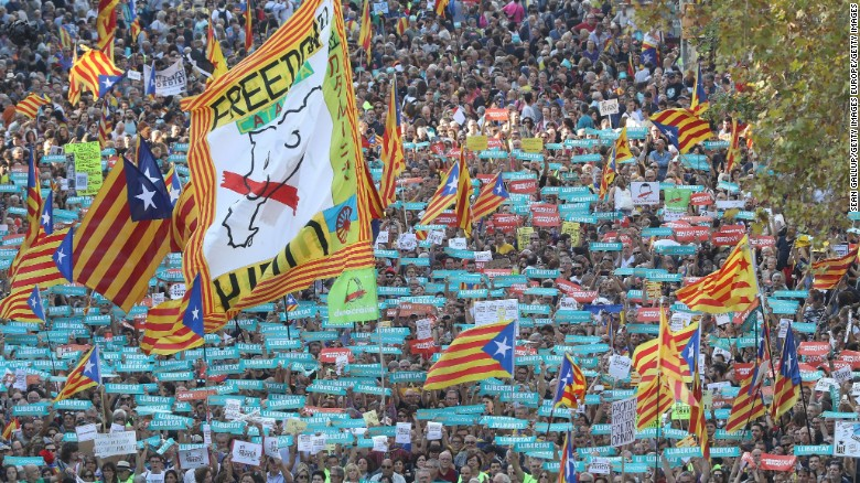Marchers demand the release of imprisoned Catalan leaders Jordi Sanchez and Jordi Cuixart on Saturday in Barcelona.