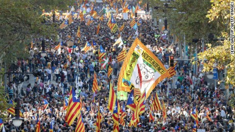 BARCELONA, SPAIN - OCTOBER 21:  Protesters wave Catalan independence flags and a giant flag to demand freedom and independence as they demonstrate against the Spanish federal government's move to suspend Catalonian autonomy and against the imprisonment of Catalan leaders Jordi Sanchez and Jordi Cuixart on October 21, 2017 in Barcelona, Spain. The Spanish government announced measures today it will implement in triggering Article 155, which would lead to the imposition of direct rule by Spanish authorities in Catalonia and at least temporarily suspend the region's autonomy. The government also plans to hold Catalan regional elections in January. The moves come after Catalan regional President Carles Puigdemont let a Thursday deadline today pass and threatened to go forward with Catalan independence.  (Photo by Sean Gallup/Getty Images)