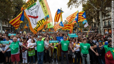BARCELONA, SPAIN - OCTOBER 21: Protesters gather in the city center to demonstrate against the Spanish federal government's move to suspend Catalonian autonomy on October 21, 2017 in Barcelona, Spain. The Spanish government announced measures today it will implement in triggering Article 155, which would lead to the imposition of direct rule by Spanish authorities in Catalonia and at least temporarily suspend the region's autonomy. Spanish Prime Minister Mariano Rajoy said he would begin the process of removing Catalan regional president Carles Puigdemont from office. The Spanish government also plans to hold Catalan regional elections in January. The moves come after Catalan regional President Carles Puigdemont let a Thursday deadline pass and threatened to go forward with Catalan independence. (Photo by Jack Taylor/Getty Images)