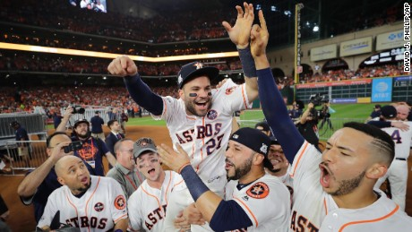 Houston Astros' Jose Altuve is lifted by teammates after Game 7 of baseball's American League Championship Series against the New York Yankees Saturday, Oct. 21, 2017, in Houston. The Astros won 4-0 to win the series.