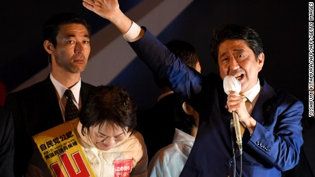 Japanese Prime Minister Shinzo Abe delivers a speech in Tokyo on Saturday night ahead of election day.