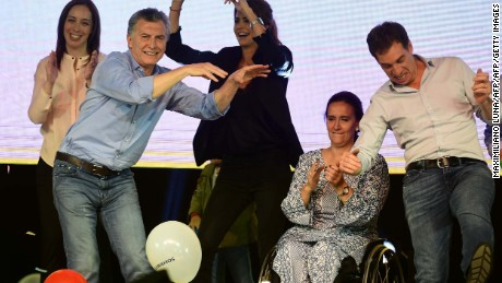 Argentina's President Mauricio Macri (2-L) dances with his wife Juliana Awada (C), Argentina's Vice President Gabriela Michetti (2-R) Buenos Aires Governor Maria Eugenia Vidal (L) and Buenos Aires vice-major Diego Santilli during a celebration after the legislative elections in Argentina, in Buenos Aires on October 23, 2017.  Argentine President Maurico Macri's center-right coalition was ahead in mid-term elections Sunday, putting him on course to strengthen his hand to carry through pro-market economic reforms, partial results showed. / AFP PHOTO / MAXIMILIANO LUNA        (Photo credit should read MAXIMILIANO LUNA/AFP/Getty Images)