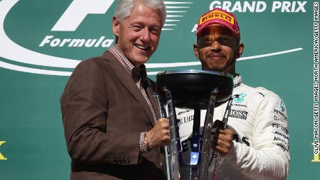 AUSTIN, TX - OCTOBER 22:  Race winner Lewis Hamilton of Great Britain and Mercedes GP is presented with the winners trophy by former President of the USA Bill Clinton during the United States Formula One Grand Prix at Circuit of The Americas on October 22, 2017 in Austin, Texas.  (Photo by Clive Mason/Getty Images)