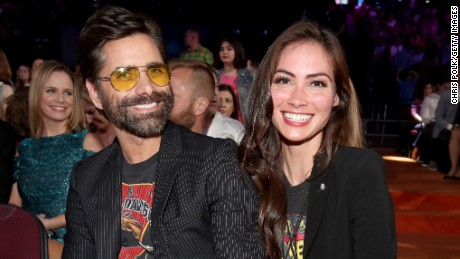 Actor John Stamos (L) and Caitlin McHugh at Nickelodeon's 2017 Kids' Choice Awards at USC Galen Center on March 11, 2017 in Los Angeles, California.