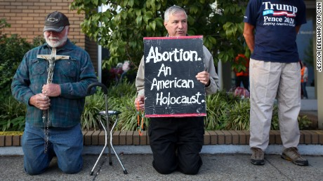 Anti-abortion demonstrators protest outside the EMW Women's Surgical Center in Louisville.