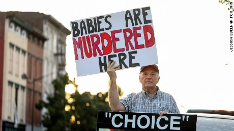 David Street demonstrates against abortion outside the EMW Women's Surgical Center in Louisville.