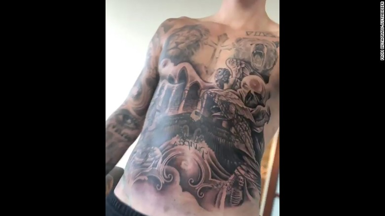 "Justin Bieber revealed his tattooed torso on his Instagram account in October. Celebrity tattoo artist Keith ""Bang Bang"" McCurd documented working on Bieber and <a href=""https://www.instagram.com/p/BahHUsOjRPJ/?taken-by=bangbangnyc"" target=""_blank"">wrote on Instagram</a> that the new ink took  ""26 hours over 3 consecutive days."""