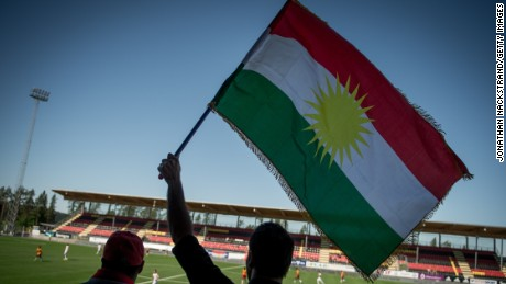 TO GO WITH AFP STORY BY TOM SULLIVAN: Kurdistan's supporters hold Kurdistan's flag and cheer their team during the CONIFA (Confederation of Independent Football) World Football Cup 2014 match between Tamil Eelam and Kurdistan on June 3, 2014 in Oestersund, Sweden. 12 teams with large refugee diaspora from four continents, including Tamils, Kurds, Sami and Occitanians, compete in Oestersund in one of the world's largest tournaments for stateless or indigenous people, regions seeking autonomy and other non-FIFA affiliated teams. AFP PHOTO/JONATHAN NACKSTRAND        (Photo credit should read JONATHAN NACKSTRAND/AFP/Getty Images)