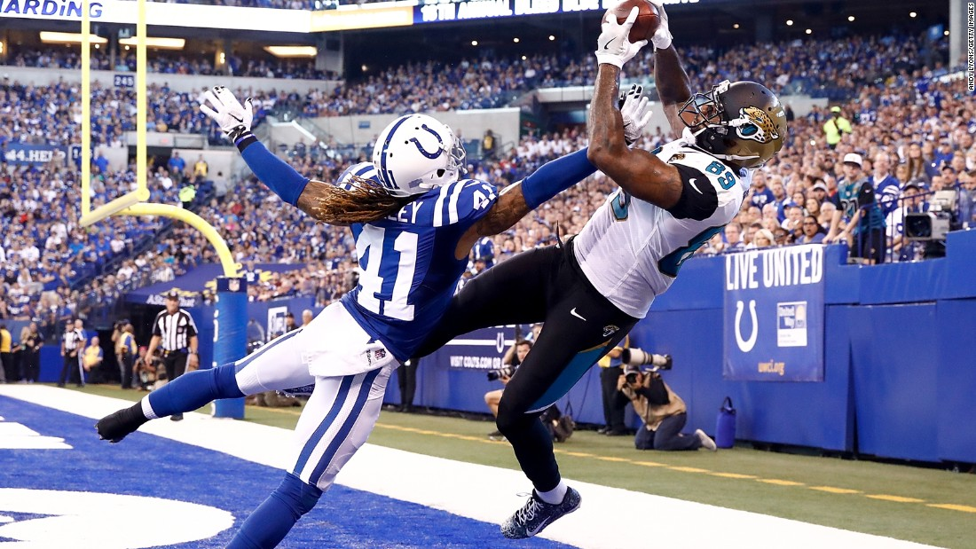 Jacksonville tight end Marcedes Lewis catches a touchdown pass over Indianapolis' Matthias Farley during an NFL game on Sunday, October 22. Jacksonville shut out the Colts 27-0.