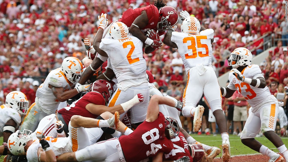 Alabama running back Bo Scarbrough leaps over the goal line to score a touchdown against Tennessee on Saturday, October 21. Scarbrough scored two touchdowns in the Crimson Tide's 45-7 victory.