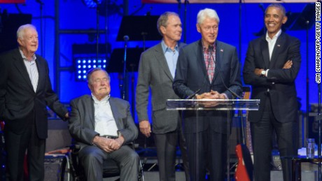 (L-R) Former US Presidents, Jimmy Carter, George H. W. Bush,George W. Bush, Bill Clinton and Barack Obama attend the Hurricane Relief concert in College Station, Texas, on October 21, 2017. (JIM CHAPIN/AFP/Getty Images)