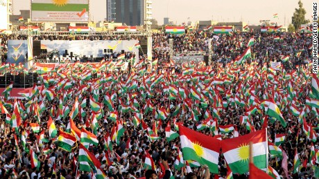 Iraqi Kurds fly Kurdish flags during an event to urge people to vote in the upcoming independence referendum in Arbil, the capital of the autonomous Kurdish region of northern Iraq, on September 22, 2017. Iraqi Kurdish leader Massud Barzani insisted that a controversial September 25 independence referendum for his autonomous Kurdish region in northern Iraq will go ahead, even as last-minute negotiations aimed to change his mind. / AFP PHOTO / SAFIN HAMED        (Photo credit should read SAFIN HAMED/AFP/Getty Images)