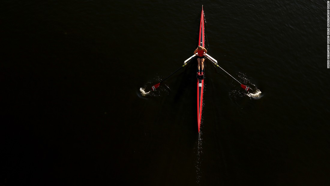 A rower makes her way to the starting line before the Head of the Charles Regatta in Boston on Saturday, October 21.