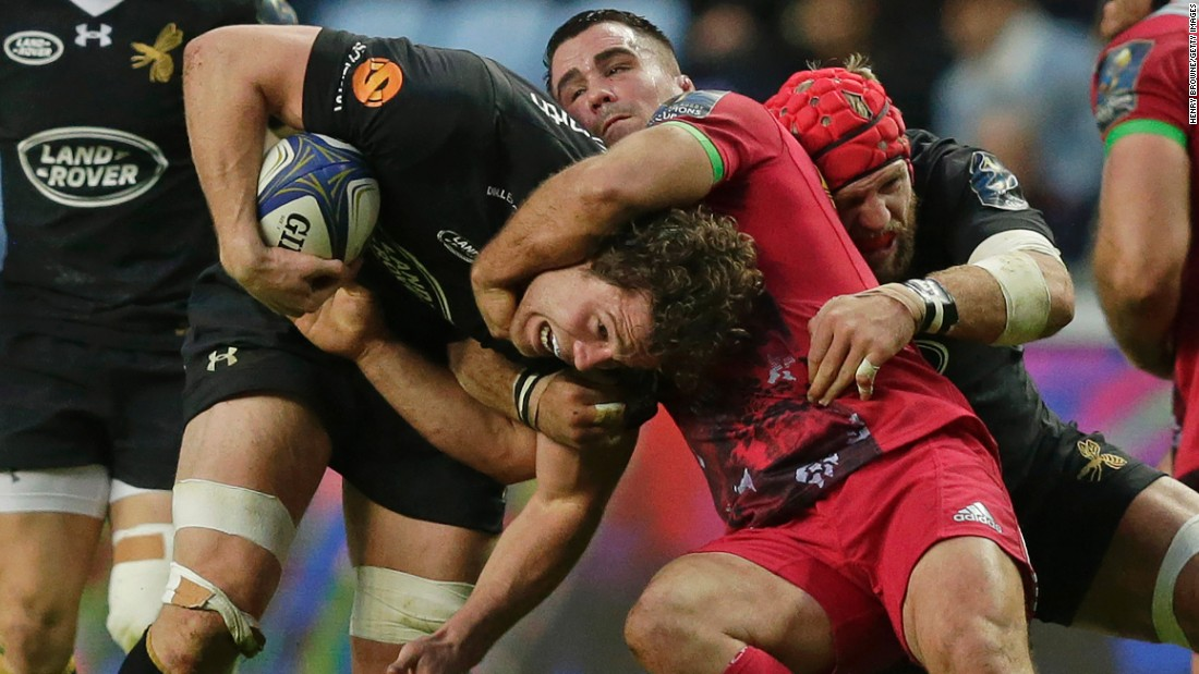 Wasps rugby player Will Rowlands is tackled by Harlequin's Dave Ward during a Champions Cup match in Coventry, England, on Sunday, October 22.