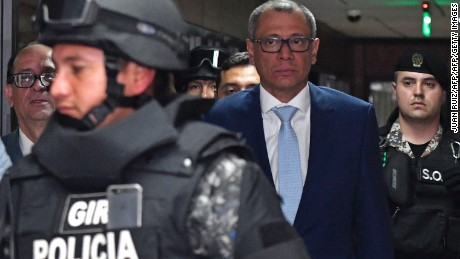 Ecuadorean Vice President, Jorge Glas (2-R) is escorted back to the court room next to his lawyer Eduardo Franco Loor (R), during his habeas corpus hearing at the National Court of Justice in Quito on October 15, 2017. Glas is kept in jail pending a criminal investigation into allegations he took $16 million in bribes from Brazil's Odebrecht, told AFP Saturday he is a victim of revenge by the construction giant. Glas on October 2 became the highest-ranking serving politician to go down as a suspected recipient of illegal kickbacks from the Brazilian group for helping it get public contracts.  / AFP PHOTO / Juan Ruiz        (Photo credit should read JUAN RUIZ/AFP/Getty Images)