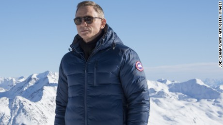 British actor Daniel Craig poses with Tyrolean Alps in the background during a photo call of the new James Bond film 'SPECTRE' in Austrian ski resort of Soelden on January 7, 2015. AFP PHOTO/JOE KLAMAR        (Photo credit should read JOE KLAMAR/AFP/Getty Images)