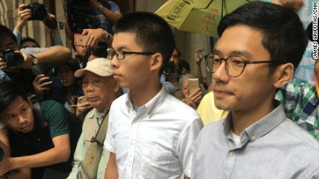 Joshua Wong and Nathan Law speak to the media after their release on bail by a Hong Kong court on October 24, 2017.