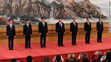 China's Xi reveals new leadership team but no obvious successor