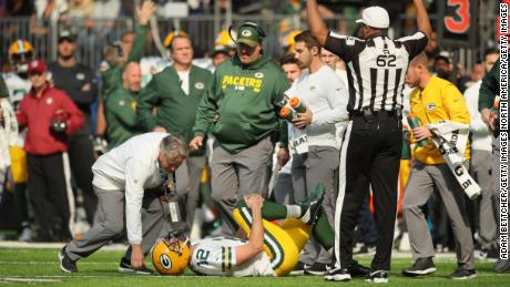 MINNEAPOLIS, MN - OCTOBER 15: Aaron Rodgers #12 of the Green Bay Packers clenches his right knee after being hit during the first quarter of the game against the Minnesota Vikings on October 15, 2017 at US Bank Stadium in Minneapolis, Minnesota. (Photo by Adam Bettcher/Getty Images)