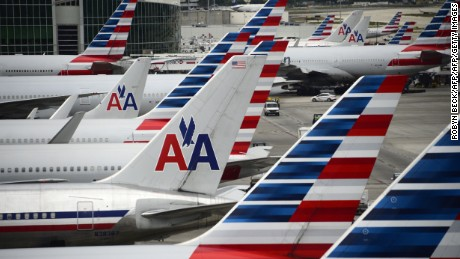 American Airlines passenger planes are seen on the tarmac at Miami International Airport in Miami, Florida, June 8, 2015.   AFP PHOTO/ROBYN BECK        (Photo credit should read ROBYN BECK/AFP/Getty Images)